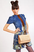 Casual young fashion holding bag — Stock Photo