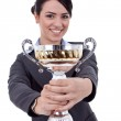 Female entrepreneur holding a trophy — Stock Photo