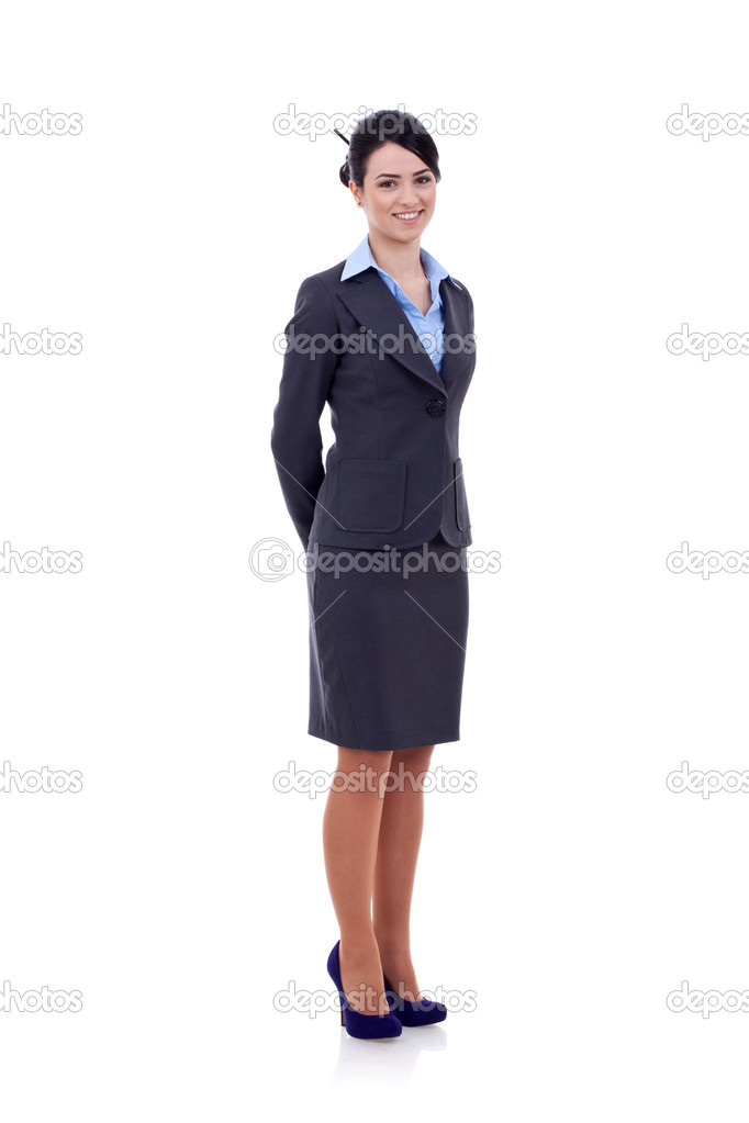 Young happy smiling business woman, with hands at her back, isolated on white  — Stock Photo #5332278