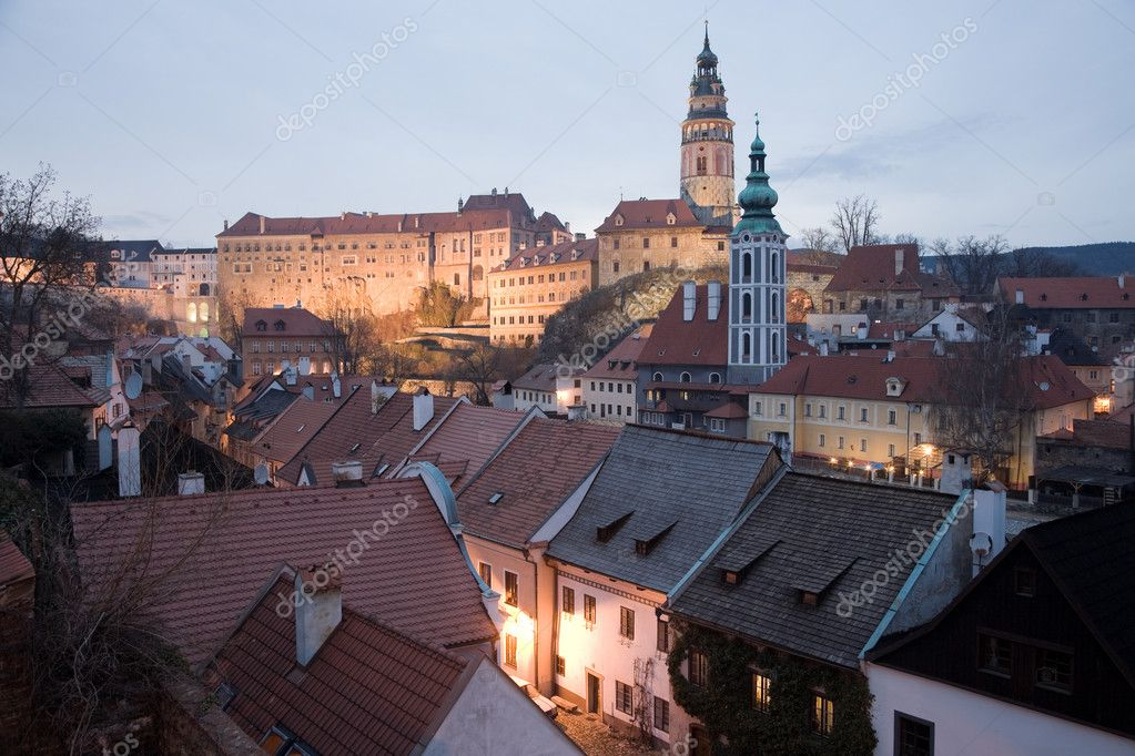 Illuminated UNESCO heritage - historic castle in Krumlov with downtown houses.  Stock Photo #4006070