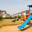 Stock Photo: Playground amidst Tudor homes