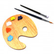 Artist palette and brushes — Stock Photo