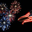 Independence day fireworks and the american flag. - 图库照片