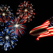 Independence day fireworks and the american flag. - Stock Photo