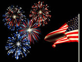 Independence day fireworks and the american flag. — Zdjęcie stockowe