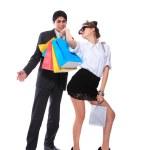 Shopping couple smiling. Isolated over white background — Stock Photo #5123447