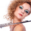 Portrait of a woman playing flute — Stock Photo #5172400