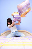 Woman having pillow fight — Stock Photo
