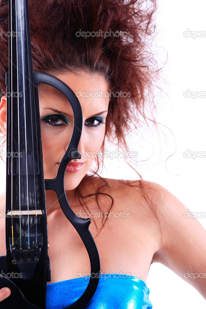 Attractive violinist playing the electric violin. Studio, white background — Stock Photo #5172347