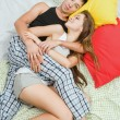 Happy couple together in bed - Foto Stock