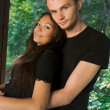 Young couple in park hugging — Stock Photo #4416892