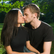 Young couple in park on a sunny day — Stock Photo
