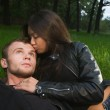 Young couple on a grass — Stock Photo #4432283