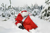 Santa claus mit seinem sack — Stockfoto