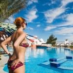 Beautiful bikini girl beside a pool — Stock Photo