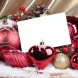 Christmas decorations with blank card over white background — Lizenzfreies Foto
