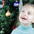 Child by the Christmas Tree — Stock Photo
