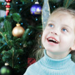 Stock Photo: Child by the Christmas Tree