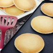 Stock Photo: Pancakes on Hot Griddle