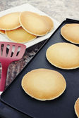 Pancakes on a Hot Griddle — Stock Photo