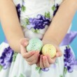 Holding Easter Eggs — Stock Photo
