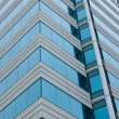 A Highrise Office Building made of Concrete and Glass - Stock Photo