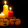 Mini Pumpkins with Funny Faces and Candles — Stock Photo