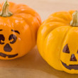 Mini Jack-o-Lanterns on a Wooden Cutting Board — Stock Photo