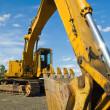 Stock Photo: Heavy Duty Construction Equipment Parked at Worksite