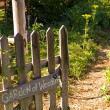 Stock Photo: Country Garden Gate Leading to Garden of Weedin