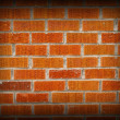 Royalty-Free Stock Photo: Red and Orange Brick Background with Dark Edge