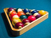 Billiards balls on a green pool table — Stock Photo