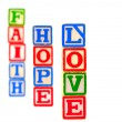 Colorful Alphabet Blocks FAITH HOPE and LOVE — Stock Photo #5101535
