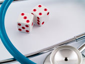 White Dice with Red Dots and a Stethoscope — Stock Photo