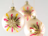 Three Christmas balls hanging Shallow depth of field — Stock Photo