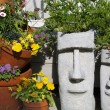 Easter Island Statue Planters with Foliage Hair - Stock Photo