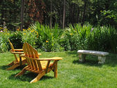 Adirondack Chairs on a lawn on a sunny day — Photo