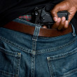 Gun in Pants — Stock Photo