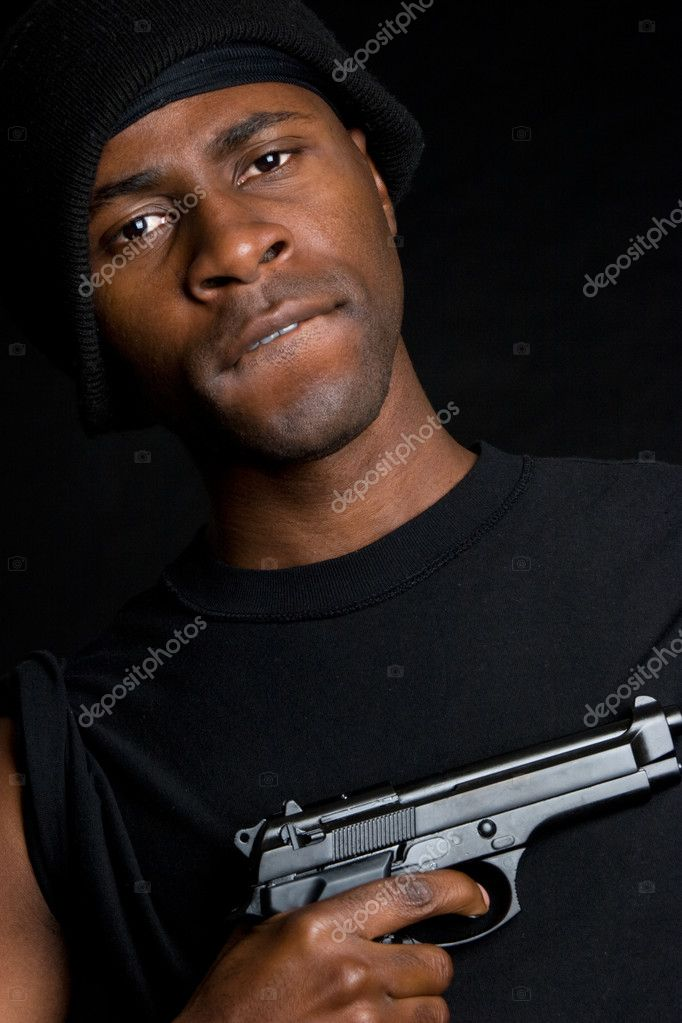 African american gangster holding gun — Stock Photo #4040033