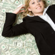 Laying in Money — Stock Photo