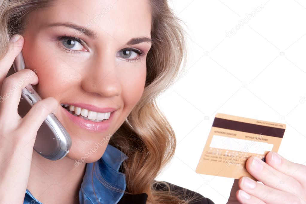 Smiling woman holding credit card  Stock Photo #4751425