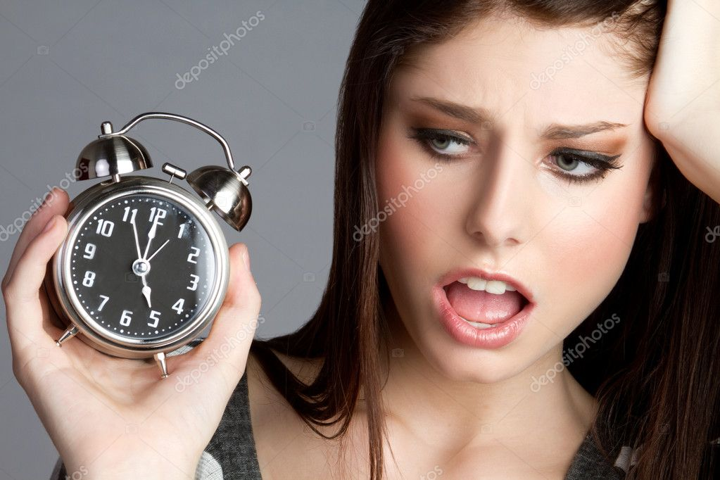 Annoyed woman holding alram clock  Stock Photo #4941006