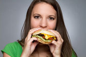 Girl Eating Hamburger — Stock Photo