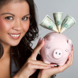 Foto Stock: Piggy Bank Woman
