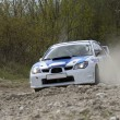White racing rally car on gravel road — Stock Photo #5210471