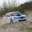 Stock Photo: White racing rally car on gravel road