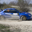 Stock Photo: Blue racing rally car on gravel road
