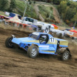 Stock Photo: Rally car on dirt gravel track
