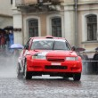 Red rally racecar on wet road — Stock Photo #5210489