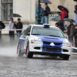 White and blue rally racecar on wet road — Stock Photo #5210491